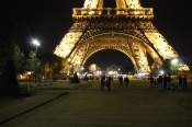 Walking under the Eiffel Tower at night