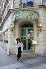 Le Cliche - Baguette, strips, and a chapeau in front of Laduree