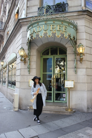 Le Cliche - Baguette, strips, and a chapeau in front of Laduree